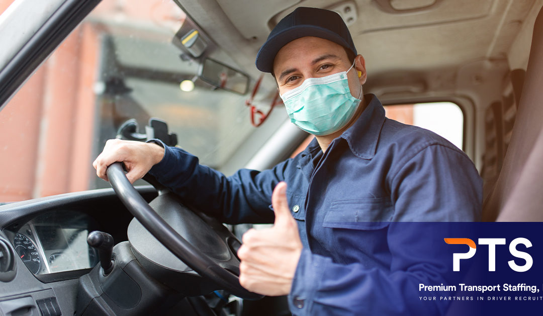 Driver wearing a medical mask and giving a thumbs up