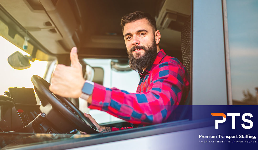 driver in a red flannel giving a thumbs up sign